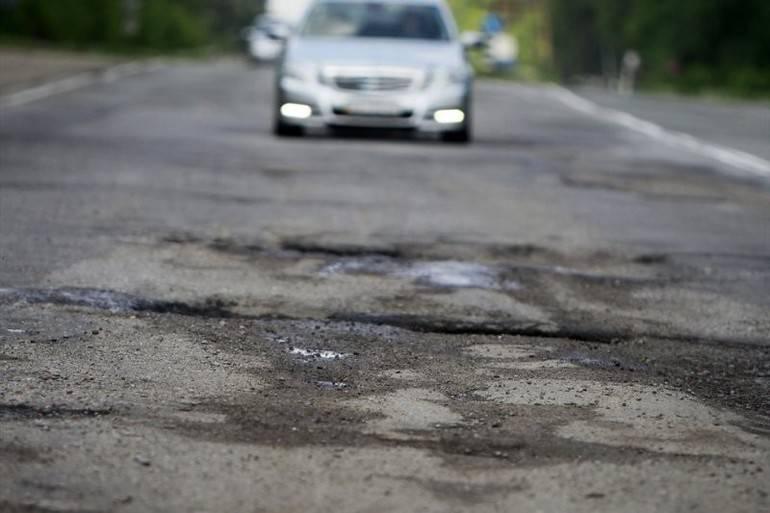 Как правильно перескочить выбоину на дороге