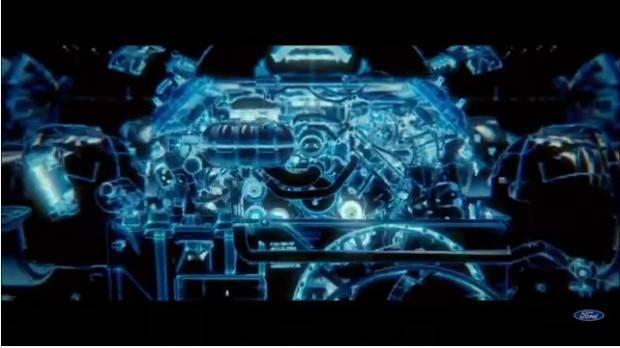 На видео видны двигатель V8 и остальные части подкапотного пространства, горящие в цвете Tron-esque, характерном именно для электрифицированных моделей Ford.